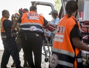 A young Jewish boy is being evacuated at Hadassah Ein Karem hospital in Jerusalem after being injured in a shooting attack near Otniel in the West Bank, on July 1, 2016. One man was killed and three others injured when their car was shot at in an attack that also caused a car collision, on route 60. Photo by Hadas Parush/Flash90 *** Local Caption *** ???? ??? ??? ????? ???? ??? ??? ????? ??? ?????? ???? 60 ??????